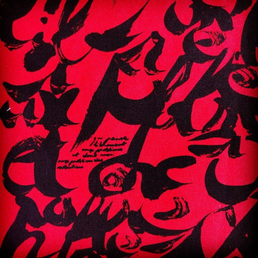 Détail du tote bag red en toile de coton biologique de Christian Dotremont artiste belge