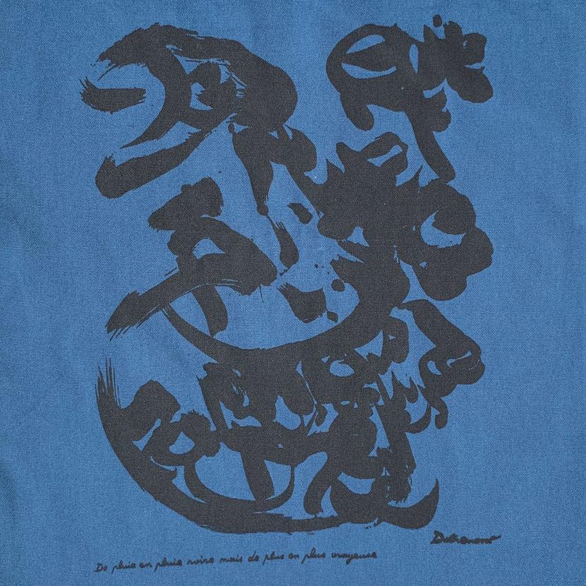détail du tote bag bleu christian dotremont